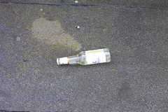 bottle unopened on roof of abandoned post office