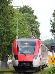 A Tag i Bergslagen (TiB) X54 'Regina' unit leaves Mora Strand with a service for Borlange, Sweden