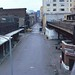 """More cloudy day wanderings in grubby old post-industrial New York. Looking south at Lower Manhattan from the abandoned New York Central Railroad (better known now as the """"High Line"""") from Washington Street. New York. March 1982 by wavz13"""