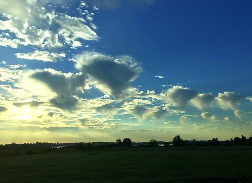 strange clouds dawn sun blue formation sunrise