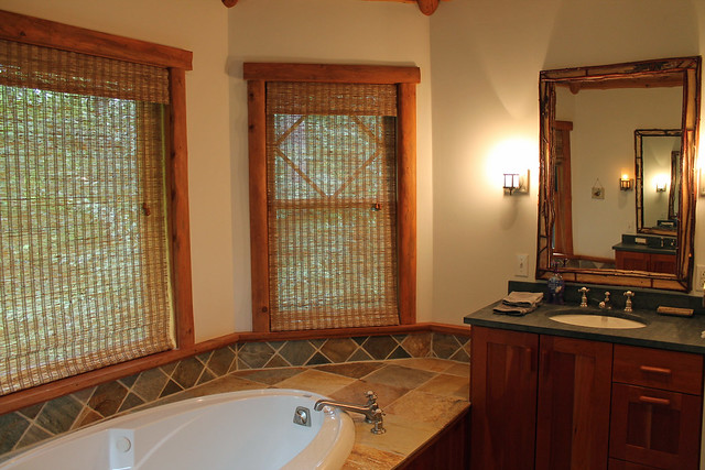 Master bathroom with jetted tub, custom tile and two vanities;