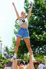 Girl Performs Cheerleading Stunt