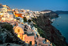 Oia colors at dusk by Michel Hincker