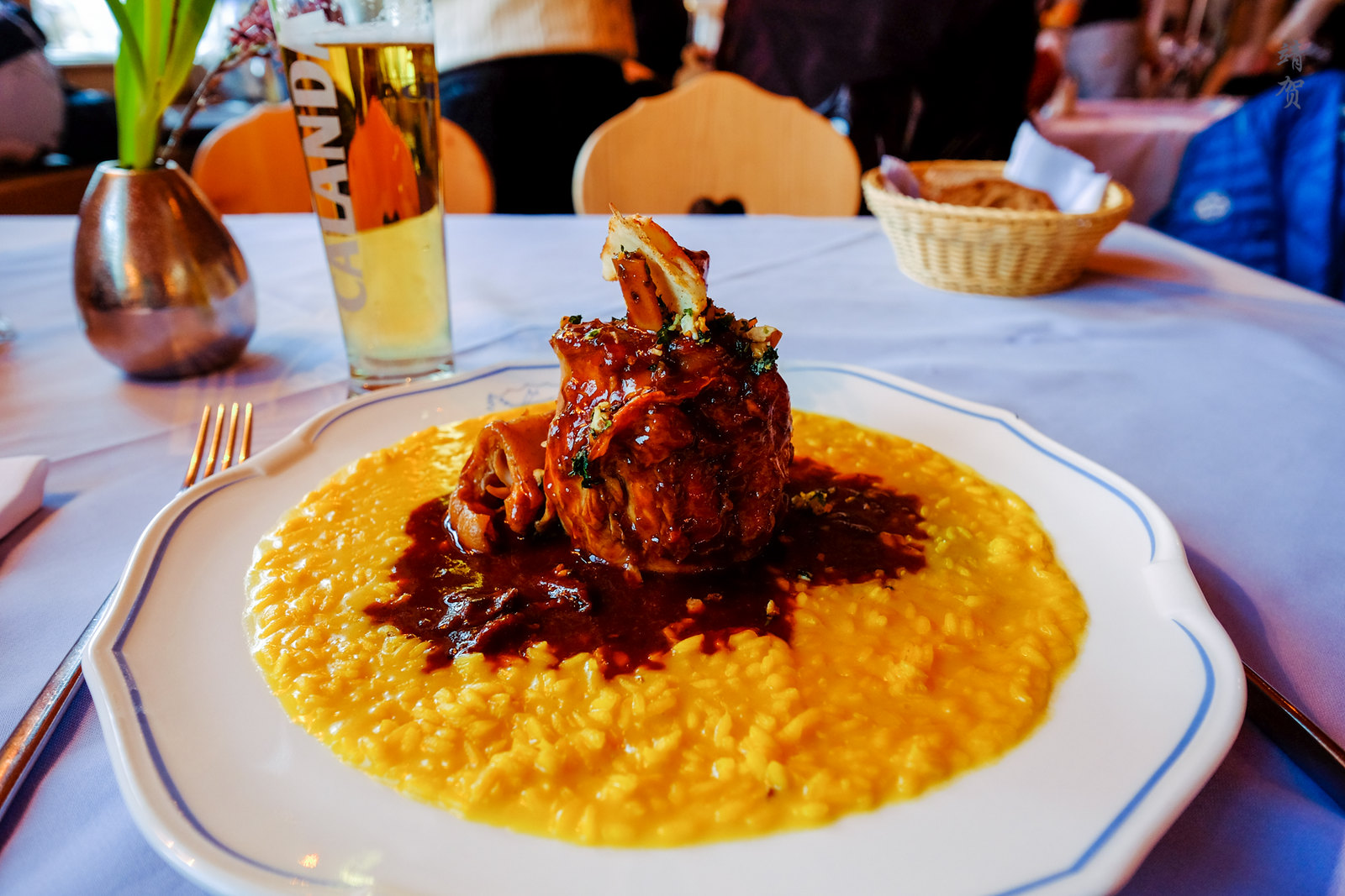 "Pork knuckles ""gremolata"" and saffron risotto"