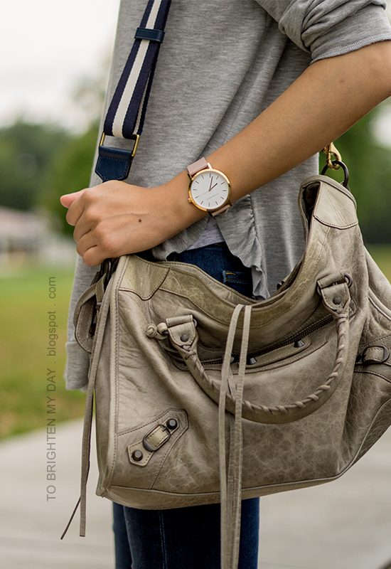 gray ruffle trim sweatshirt, skinny jeans, oversized watch, gray tote with navy stripe strap