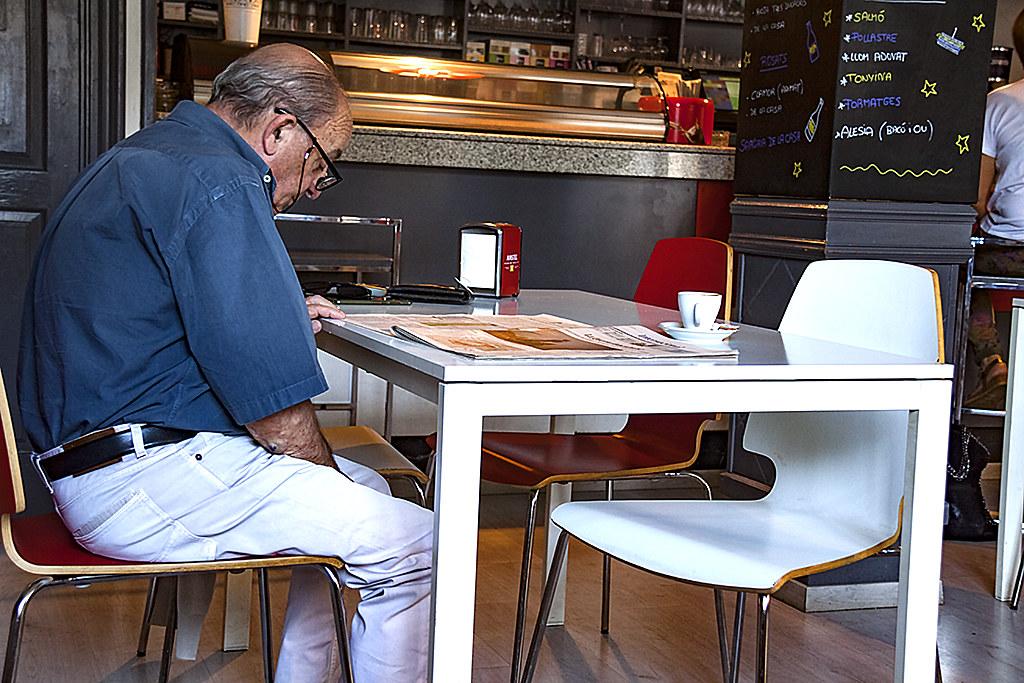Old man reading newspaper--Ripoll