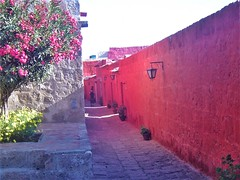 The bright red colors of the #SantaCatalina #Monastery make for a calming and soothing experience as you walk around the 'city within a city'. Check out these 5 #TreasuresOfTraveling found in #Arequipa #Peru #SouthAmerica http://treasuresoftraveling.com/5
