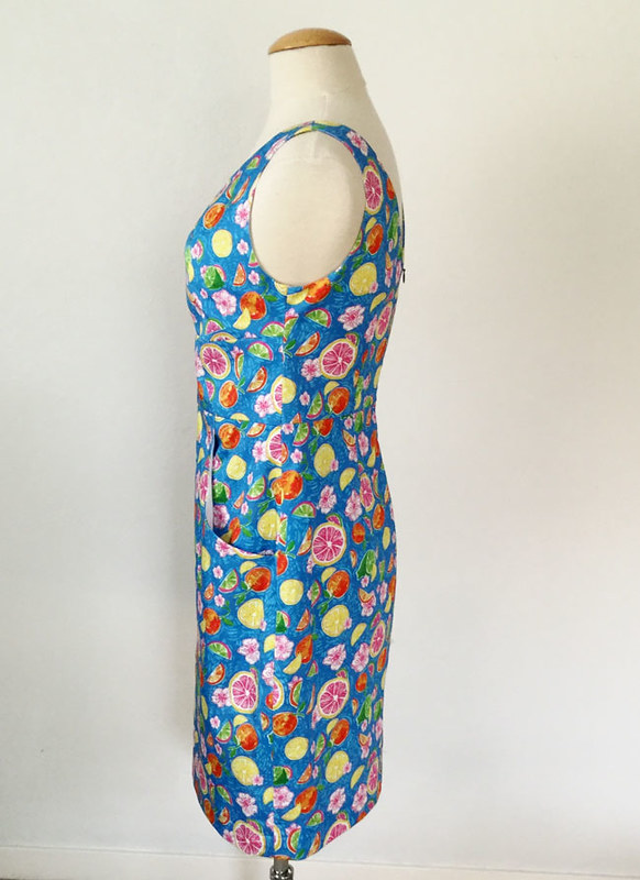 citrus dress side view on form