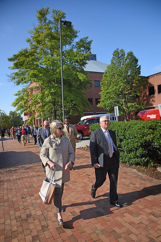 UNC system president Margaret Spellings and Chancellor Randy Woodson walk past the College of Textiles on Centennial Campus.