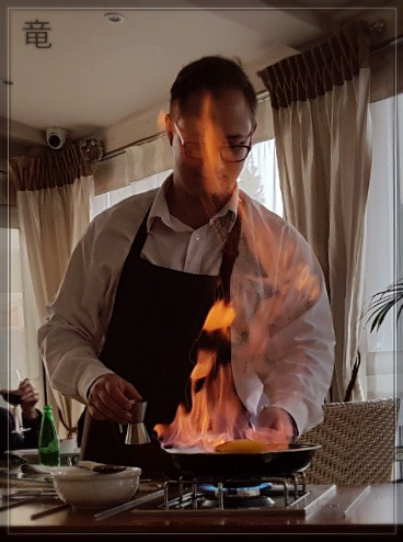 waiter preparing flamed plums