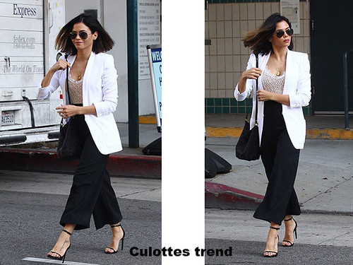 Culottes-trend, black cropped culottes, white tailored blazer, a low-cut lace bodysuit, strappy black heels, black strappy black heels, dark aviator sunglasses, transitioning fashion pieces,  autumn winter transitioning fashion pieces