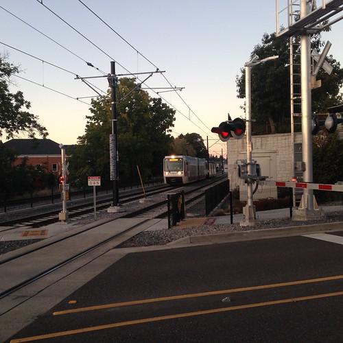 An Oak Grove-bound train passes through downtown Milwaukie