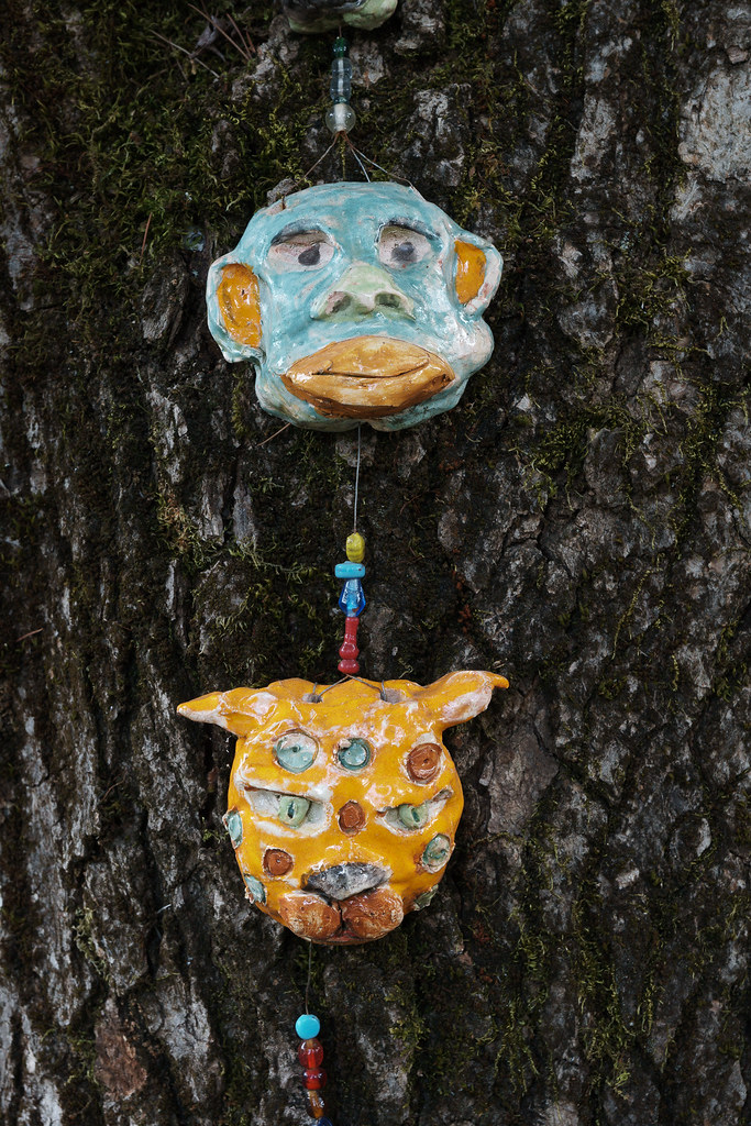 Art of a monkey and a cat are attached to a tree in the Irvington neighborhood of Portland, Oregon