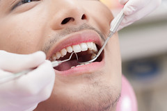 A man with dental care activity