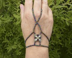 Green flower slave bracelet.