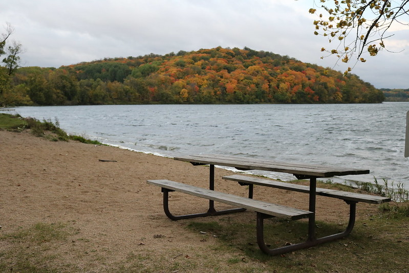 a picnic table on the sand, rough Lake Lida, and a colorful islet