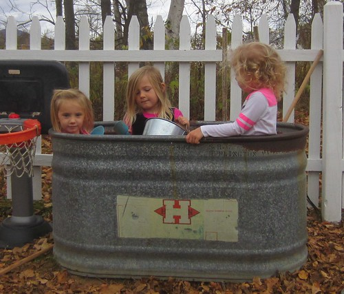 three girls in a bin