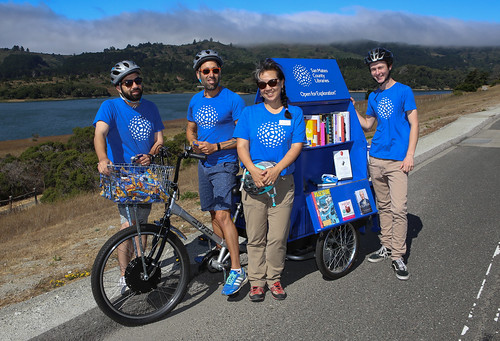 Staff and Intern posing with one of our Book Bikes.