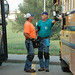 September 24, 2017 - 8:48pm - Iowa Department of Education school bus inspectors compare notes during a vehicle inspection day for an Iowa school district. In addition to their expertise, standard equipment for inspectors includes a heavy duty flashlight, a walkie talkie, an electronic tablet for documenting inspection details, and knee pads.