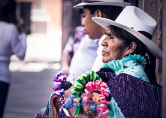 Mexican woman selling handcraft dolls