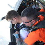 It's A Long Way Down For Tandem Skydive Student Joey With Instructor Sam Tombin and Videographer Art Farley