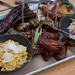 Pork ribs, pork belly lollipops, chilli & cheese sausage, coleslaw, BBQ chicken wings, creamed corn