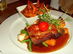 PORK BELLY 'SURF & TURF' 5 hour braised pork with roasted scallop, prawns, sweet potato fries, medley of vegetables, light spiced plum sauce