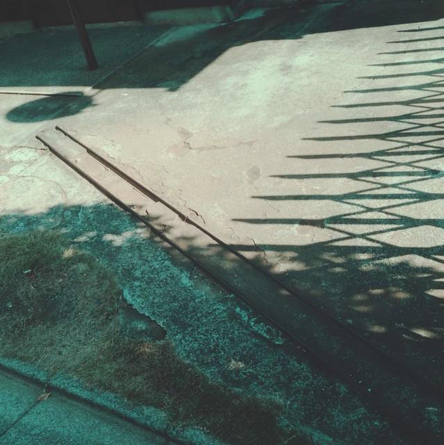 Sliding gate track
