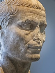 Closeup of portrait of a Roman man possibly Julius Caesar produced during the Augustan period (27 BCE - 14 CE) Marble