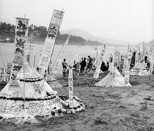 An Archive photograph of the elaborate sand stupas constructed on the sandbars of the Mekong River as part of the Lao Buddhist New Year celebrations. Courtesy of BHP