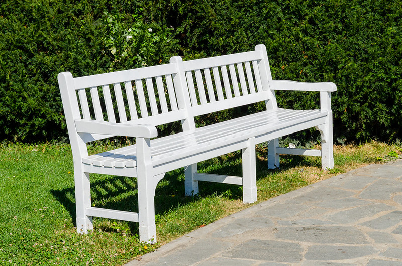 Beautiful white vintige bench in park