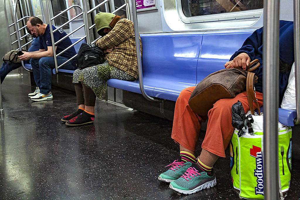 Sleepers on E Train--Manhattan