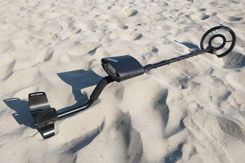 Bounty Hunter IV metal detector resting on beach