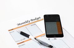 Montly Budget Sheet with Calculator and Pencil