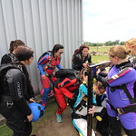 "Commonly referred to as ""dirt diving"", the ladies practice on the ground before making the actual skydive together."