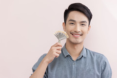 Asian male smiling in dental clinic