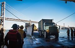 Sailors aboard USS Essex (LHD 2) prepare to bring disaster response equipment ashore in San Francisco, Oct. 2. (U.S. Navy/MC2 Eric Chan)