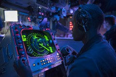 A Sailor tracks shipping in the CIC aboard USS Kearsarge.