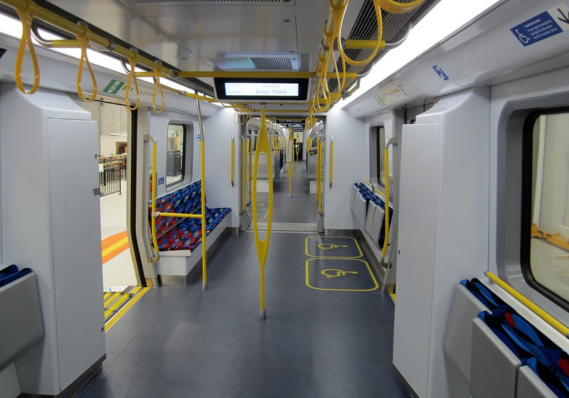 New train mock-up: standing area showing wheelchair allocated spaces and hand straps