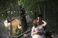 bride groom kissing light bulb background ont eh lake -1