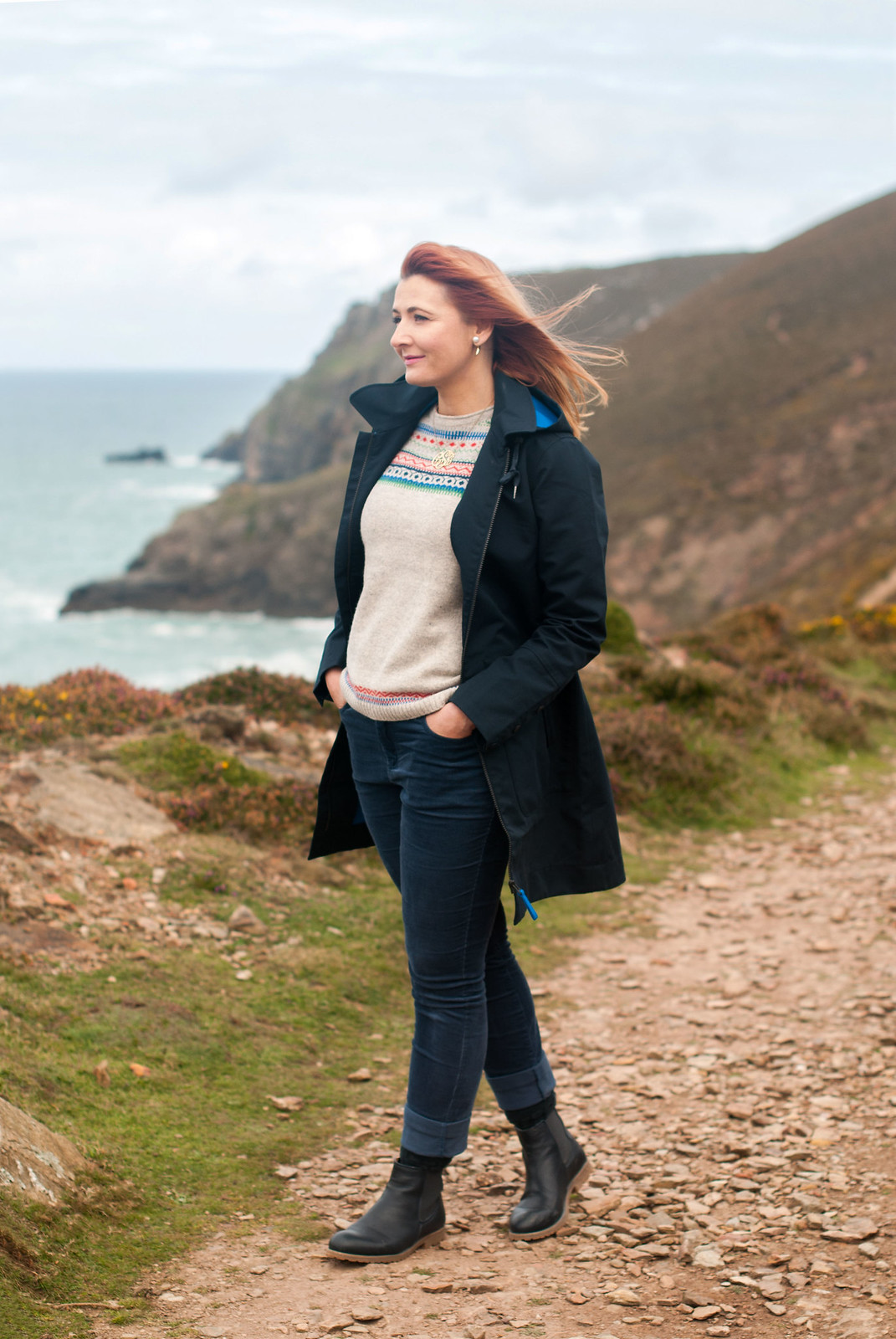 Stylish dressing for a rainy day - wearing AW17 Seasalt Cornwall in St Agnes, Cornwall: Longline navy raincoat  grey Fair Isle sweater jumper  blue corduroy trousers  navy Chelsea boots | Not Dressed As Lamb, over 40 style