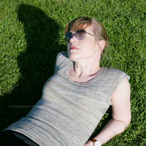 relaxing in the sun, laying on green grass
