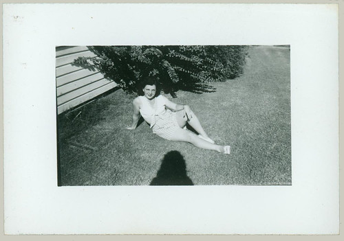 Woman sitting on the grass and shadow