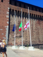 The flags of the EU, Italy and the city of Milan