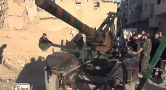 Syria-cannon-C-18km-range-2014-sfa-2