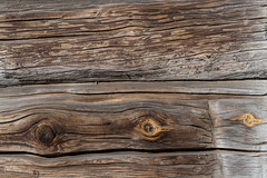Planks of wood damaged by the aging process