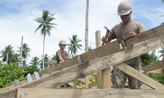 Seabees from NMCB-3 work on the roof of a structure in September being built in the Federated States of Micronesia as part of the Typhoon Maysak Reconstruction Project. (U.S. Navy/IT1 Gregory L. Parker)