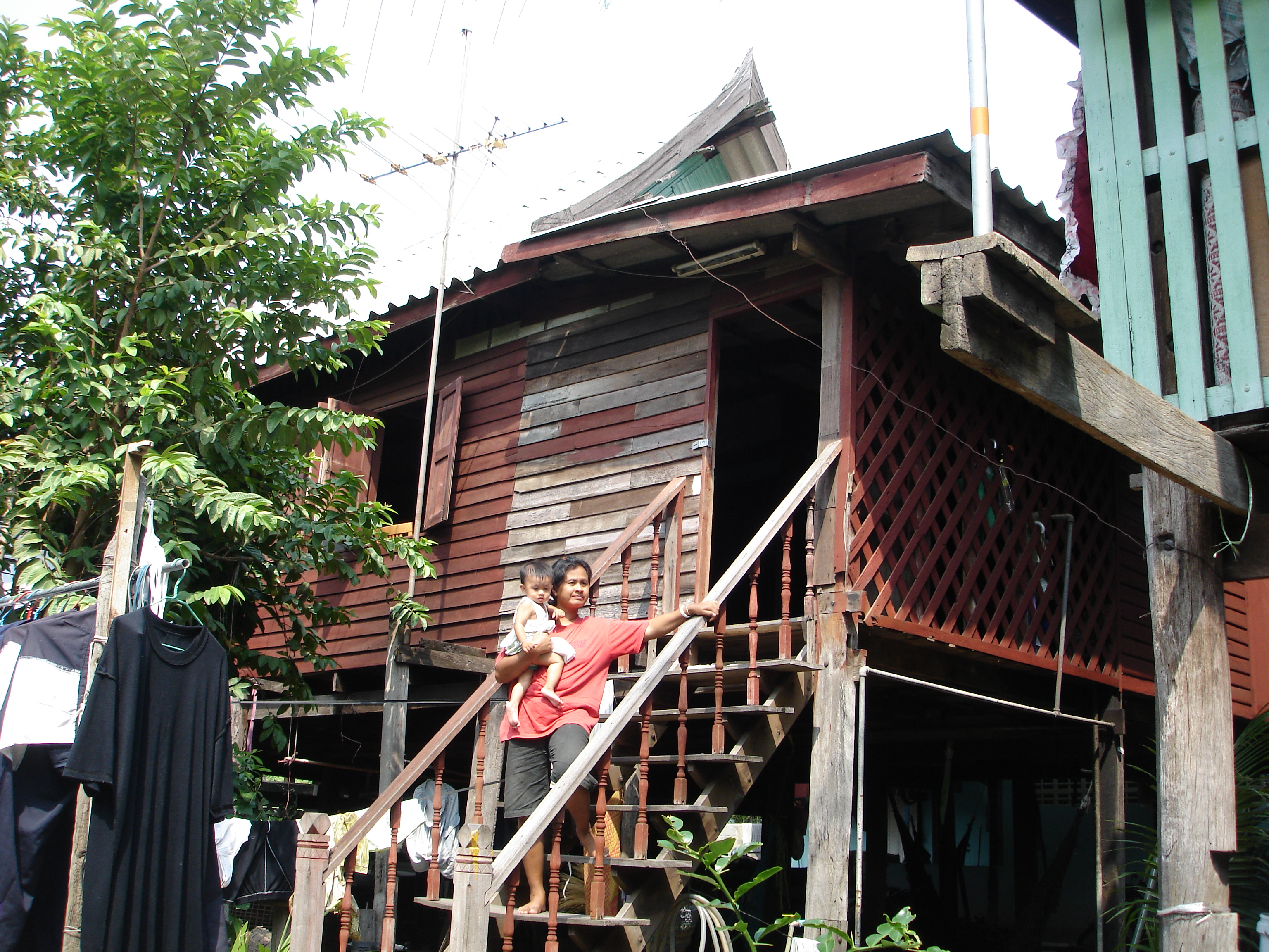 My former son-in-law's family home made a stark contrast to the stately buildings of Bang Pa-In Royal Palace, just two kilometers further down the road. Photo taken by Mark Jochim on May 16, 2006.