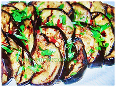 Slices of Solanum melongena (Brinjal, Eggplant, Aubergine Terong in Malay) cooked as a dish, 30 Sept 2017