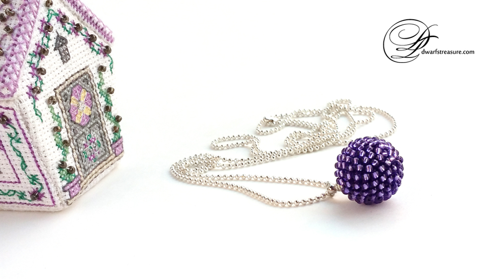pretty ball chain necklace with purple beaded bead pendant and cross stitched house